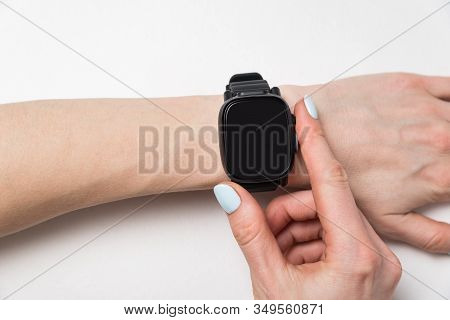 Fashion Watch On A Woman's Wrist. Smart Watch On White Background. Copy Space
