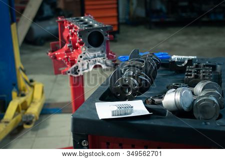 Car Cylinder Block And Crankshaft In Workshop. Engine Overhaul In A Small Service