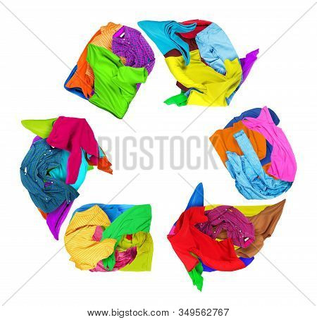 Clothes Folded In A Recycling Sign On A White Background