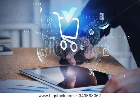 Hands Of Man Using Tablet In Blurry Office With Double Exposure Of Futuristic Online Shopping Interf