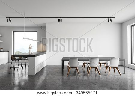 White Kitchen Interior With Bar And Table