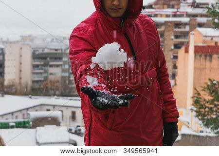 Detailed Shot Of A Young Man Playing With The Snow. Lifestyle And Winter Concept