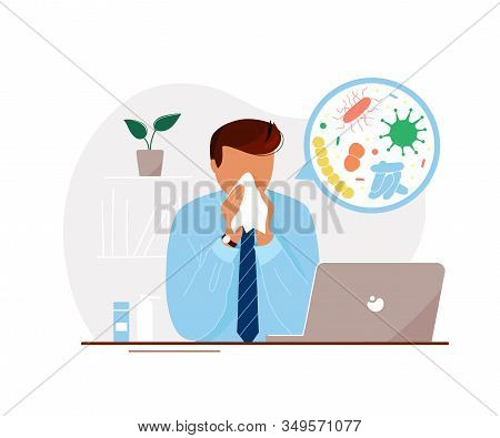 Young Man With Flu Sitting At Laptop In Office Until Late And Blowing His Nose With Microorganisms I