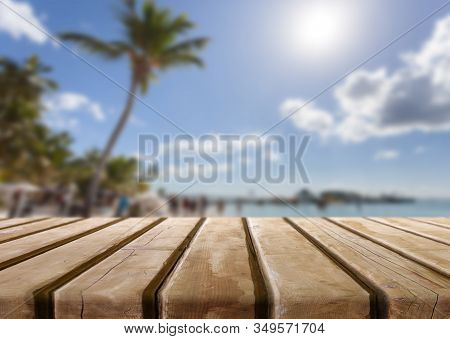 Wooden Textured Desk With Blur Natural Beach Background