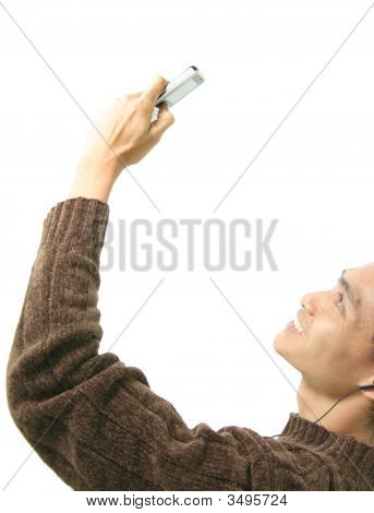 Man And Cellular Phone With Headphone