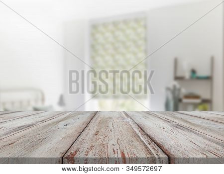 Wooden Textured Desk With Blur Interior Background
