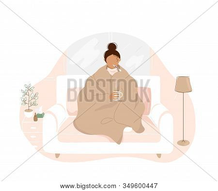 Sick Woman With Flu Covered With Warm Blanket Sitting On Sofa , Holding Cup With Hot Tea In Hand And