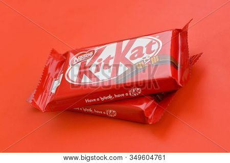 Kit Kat Chocolate Bar In Red Wrapping Lies On Red Background. Kit Kat Created By Rowntrees Of York I