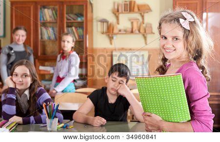 Pretty Teen Schoolgirl In Front Of Class