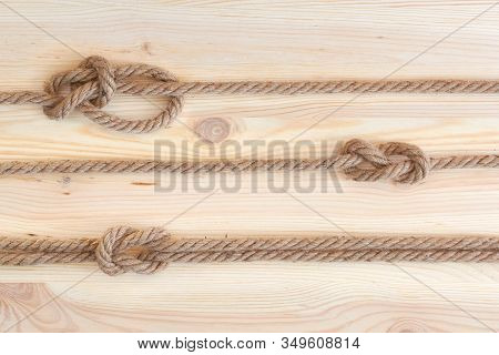 Marine Knots Used In Yachting: Figure Eight Knot, Square Knot, Bowline Knot. Nautical Knots On Woode