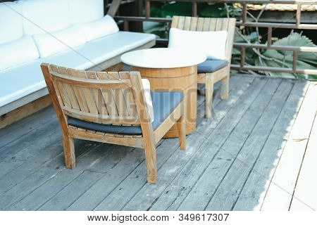 Wooden Chair And Sofa Couch For Relaxing On Terrace Balcony