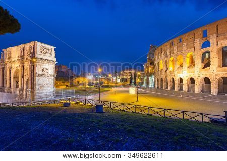 Arch of Constantine and the Colosseum illuminated at night in Rome, Italy
