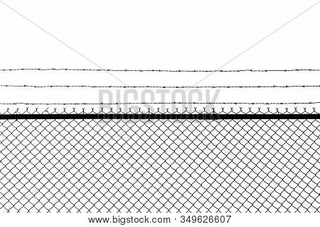 Metal Fence With Barbed Wire Isolated On A White Background.