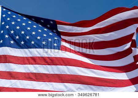 Usa Flag On A Blue Sky Background.