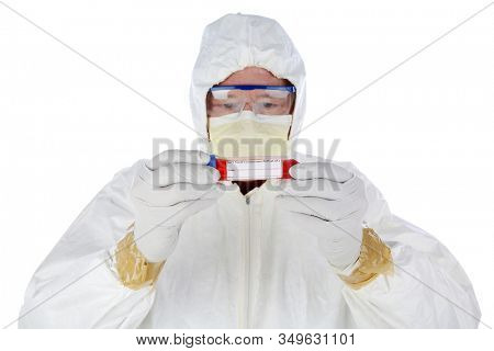 2019 Novel Coronavirus. 2019-nCoV.  Wuhan, China Coronavirus. Doctor or Medical Scientist examines a vile of blood infected with the Wuhan, China Coronavirus. Doctor in Protective suit with virus.