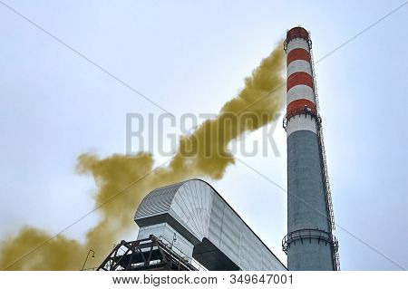 High Factory Chimney Emits Dense Puffs Of Toxic Green Smoke Into The Environment. Harmful Production