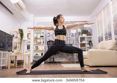 Attractive Caucasian Woman Doing Virabhadrasana Yoga Pose