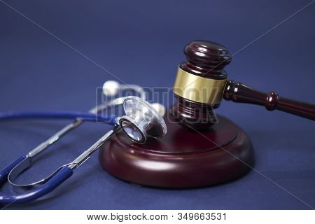 Stethoscope And Judgement Hammer. Gavel And Stethoscope. Medical Jurisprudence. Legal Definition Of