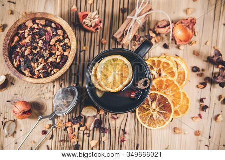 Cup Of Fruit Tea With Dry Orange And Cinnamon On Wooden Table. Topview,  From Above