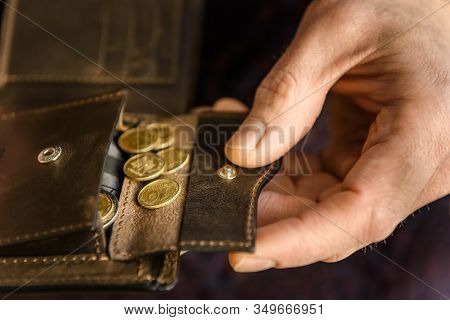 Brown Leather Wallet With Coints In The Hands. Close Up.