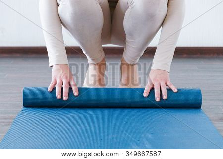 Beautiful Girl Getting Ready For Yoga Indoors In Daylight. Active Lifestyle.