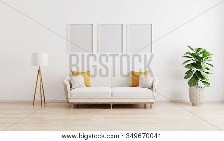 Three Blank Poster Frame In Bright Modern Living Room With White Sofa, Floor Lamp And Green Plant On