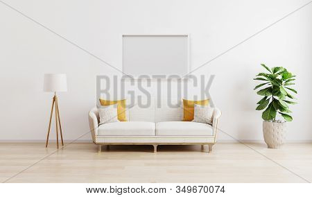 Horizontal Picture Frame In Bright Modern Living Room With White Sofa, Floor Lamp And Green Plant On