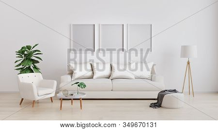 Three Poster Blank Frames In Stylish Interior Of Bright Living Room With White Sofa And Armchair, Fl