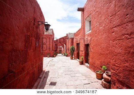 Arches On The Streets In The Monastery Of Santa Catalina, Arequipa, Peru, Large Cacti And Geraniums