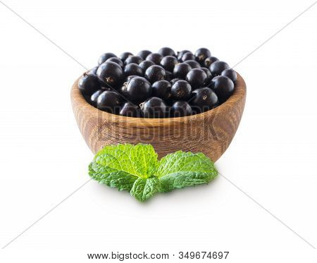 Black Berries Isolated. Blackcurrants In A Wooden Bowl Isolated On White Background. Blackcurrants W