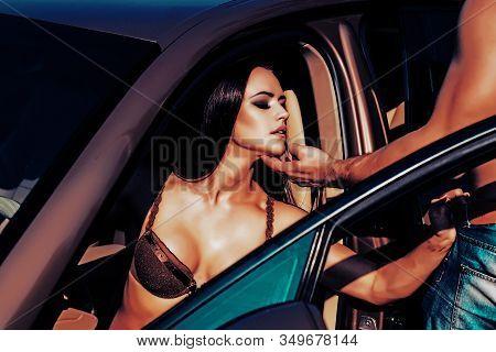 Beautiful Luxurious Woman Sitting In Sport Car. Sport Car And Luxurious Woman. Luxury Woman