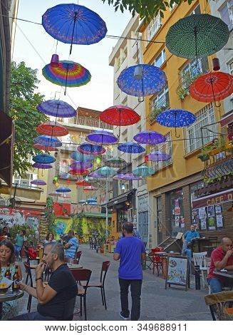 Istanbul, Turkey - September 18th 2019. Colourful Umbrellas Hang From The Sky Covering A Street Of B
