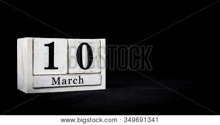 March 10th, Tenth Of March, Day 10 Of Month March - White Calendar Blocks On Black Textured Backgrou