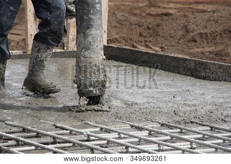 The Process Of Pouring Concrete At A Construction Site. Concreting The Base Of A Building Under Cons