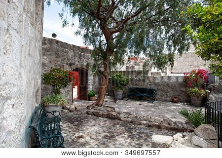 A Secluded Place, A Place To Relax, A Bench And A Tree In Monastery Santa Catalina, Arequipa, Peru