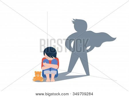 Sad Little Boy With Teddy Bear Sitting On Floor, Superhero Shadow On The Wall. Child Abuse, Violence