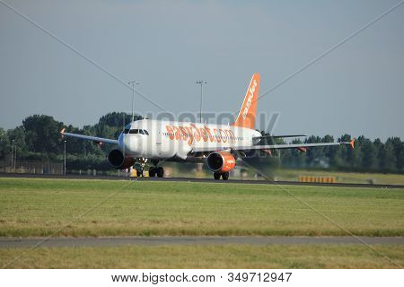Amsterdam, The Netherlands  - August, 18th 2016: G-eztx Easyjet Airbus A320-214  Taking Off From Pol
