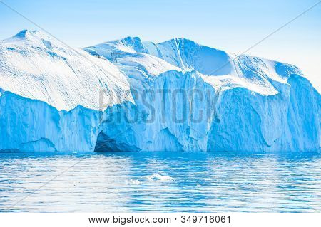 Big Blue Icebergs In The Ilulissat Icefjord, West Coast Of Greenland