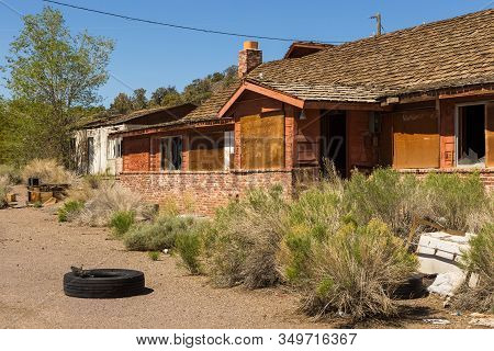Abandoned, Destroyed Buildings At 6 Road. Damaged Tire In Front Of The House. Ghost Town, Inyo Natio