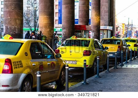 Taxi Cars Waiting For Clients In Front Of The North Railway Station (gara De Nord). Taxi Station In
