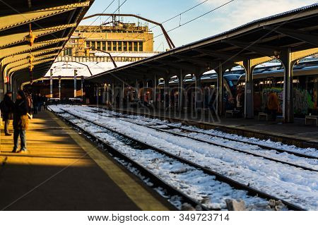 Travelers And Commuters Waiting For A Train On The Platform Of Bucharest North Railway Station (gara