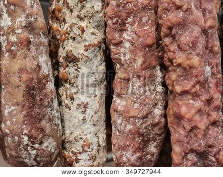 Closeup View Of Different Varieties Of Dry Sausages And Spanish Chorizos On A Local Market