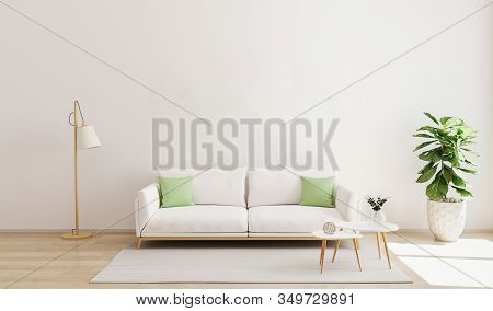 Living Room Interior With White Sofa And Green Pillows, Modern Coffe Table, Floor Lamp, Plant And Ru
