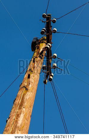 Electricity Pylon.  A Wooden Electricity Pylon With Cables.
