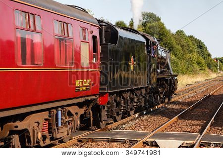 Appleby, England - August 25:  The Train Driver Aboard A Stanier Class 8f Steam Locomotive Looks Bac