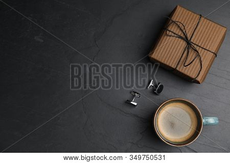 Cup Of Coffee, Gift Box And Cuff Links On Black Table, Flat Lay With Space For Text. Happy Father's