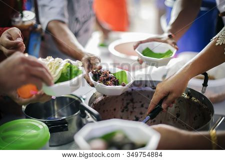 Volunteers Give Food To The Poor : Donating Food Is Helping Human Friends In Society : Helping Peopl