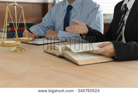 Lawyers Having Team Meeting In Law Firm. Concepts Of Law, Legal Services, Legislation.