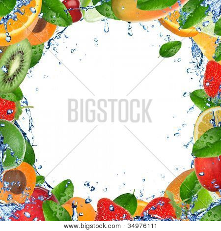 Fresh healthy fruit background with splashing water