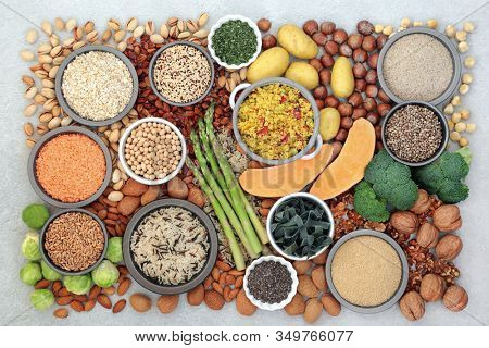 Vegan food for a healthy diet with foods high in protein, vitamins, minerals,omega 3, antioxidants, smart carbs & dietary fibre. Ethical eating concept. Flat lay, top view.